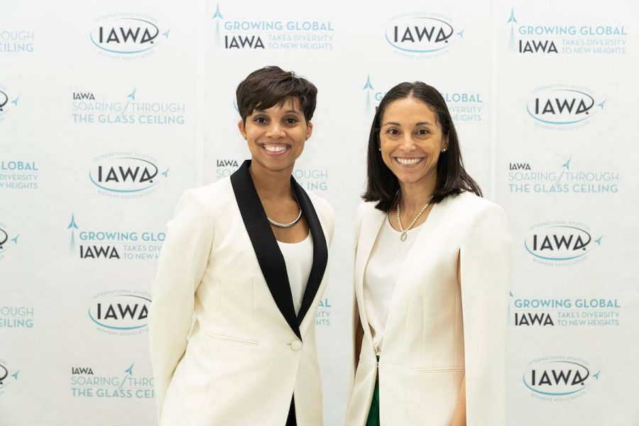 Two women smiling at the IAWA conference.
