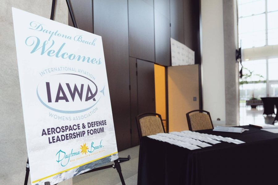 The sign in area for the IAWA conference with table and chairs.