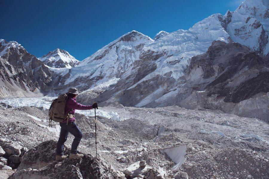 Women in purple sweater climbing Mount Everest